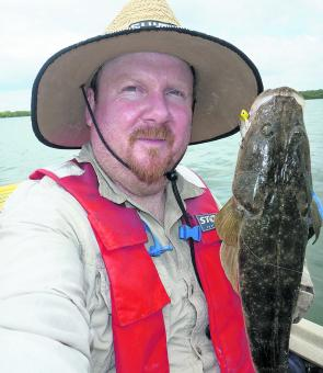 Justin Wilmer with a modest Pumicestone flathead caught on a blade.