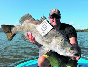 Peter Beherens of Team 13 Fishing holds up 95cm of Teemburra barra, the biggest for the comp.