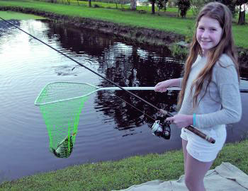 Tilapia are handy for introducing youngsters to fishing. Gabby looks very happy with her fish.