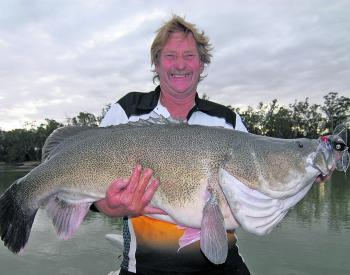 Troy Harvey with a 114cm surface caught cod he landed on the Murray River.