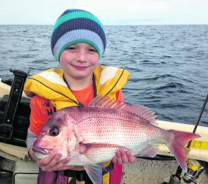 This snapper was caught by Naite Turner. He's a little champion and out-fishes adults most days.