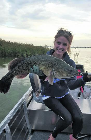 Daneka Robinson with an 80cm cod she caught off the surface.