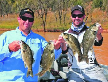The author and Joshua Higgs caught these bass on plastics fished vertically.
