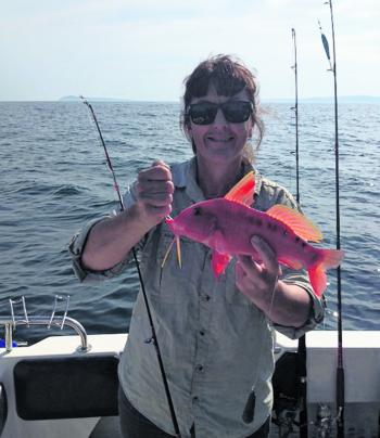 Amanda Kelliar with a red mullet or the 'chicken of the sea,' as they are known.