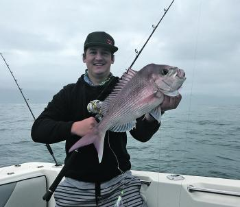 Justin with a rare snapper. Some say it was definitely bought from a fish shop.