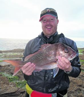 John Halford with a 53cm snapper caught in the wash zone.