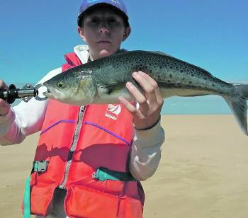 Seth Steed fishing from his kayak bagged a 59cm salmon on a metal lure.