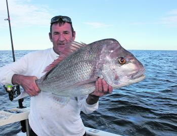 Ross with a snapper he caught and released at Caloundra.