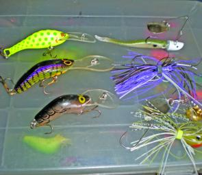 "At left, from top, three great Aussie-made trolling minnows that get down around 5m to 6m: Stuckey, Viking Talisman, Halco Poltergeist. At right, bladed lures for fishing the weed and thick timber: from top, Berkley 3"" Hollowbelly Split Tail on 1/4oz Nitr"