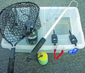 These items are essential to have on board a kayak to catch and land fish successfully.