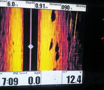 Side imaging sounders like this Humminbird 1198 are valuable when it comes to locating fish. There's no mistaking when barra are cruising past the boat.
