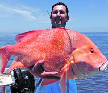 Mark Simkins with his PB red emperor caught on Reel Naughti.