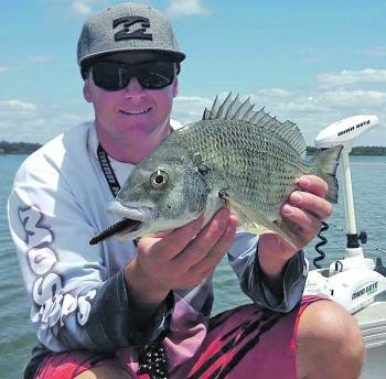 Wazza Schmidt with a monster of a Moreton Bay bream. Check out the lips! This fish took a liking to a surface stickbait.